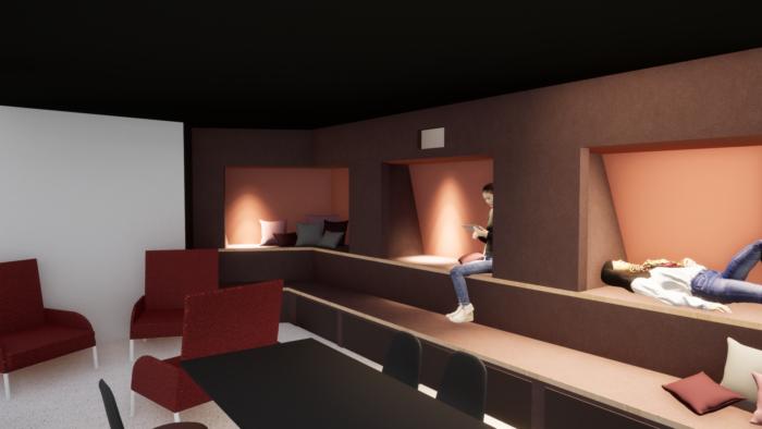 Huone, jossa nojatuoleja, pöytä ja lukusoppeja.