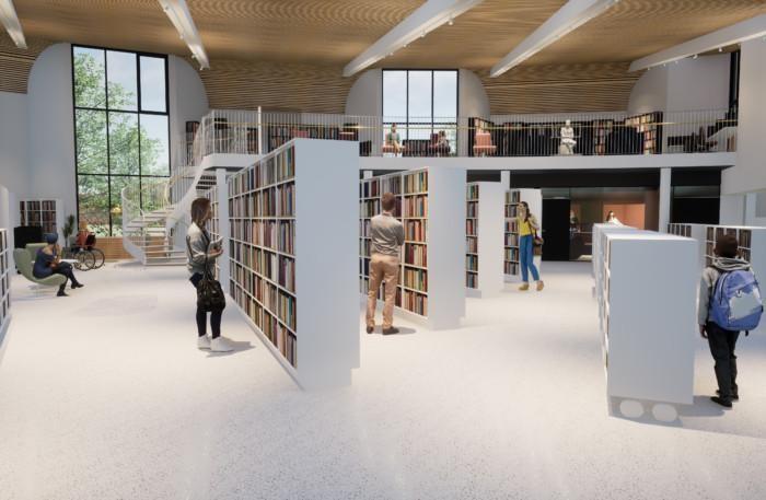 Lattiatasolla valkoisia kirjahyllyjä. Portaikosta pääsee parvelle, jossa tummia kirjahyllyjä ja Kiven patsas.